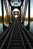 Railroad Bridge. Railroad tracks on scaled bridge crossing river into the distance Stock Images