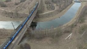 Railroad bridge. Across the river. The train moves on the bridge stock video footage