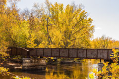 Railroad Bridge in Autumn Trees Stock Image