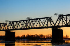 Railroad bridge and construction site on river bank Stock Photos