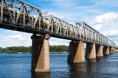 Railroad bridge in Kyiv across the Dnieper with freight train Stock Photography