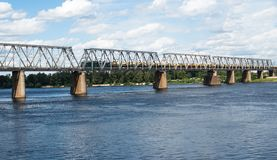 Railroad bridge in Kyiv across the Dnieper with freight train Stock Photo