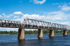 Railroad bridge in Kyiv across the Dnieper with freight train Royalty Free Stock Photo