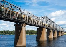 Railroad bridge in Kyiv across the Dnieper with freight train Royalty Free Stock Photography