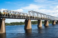 Railroad bridge in Kyiv across the Dnieper with freight train Stock Image