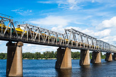 Railroad bridge in Kyiv across the Dnieper with freight train Royalty Free Stock Image