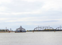 Railroad Bridge on Mississippi River. A railroad bridge on the Mississippi River turns to allow river traffic through royalty free stock photography