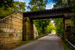 Railroad bridge over a road in rural York County, Pennsylvania. Stock Photography
