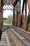 Railroad Bridge Over Water in Autumn Royalty Free Stock Photography