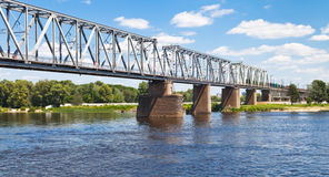 Railroad bridge through river Royalty Free Stock Photos