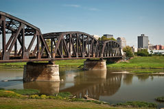Railroad Bridge To City stock photo