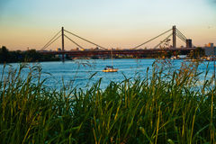 Railroad cable bridge over Sava river at golden hour in Belgrade Royalty Free Stock Photo