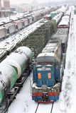 Railroad cargo junction. Several cargo carriages at railway junction at snowing day Royalty Free Stock Photography