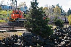 Steilacoom Washington. A railroad cargo train passes a section of rocky beach in Steilacoom, Washington stock image