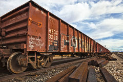 Railroad Cars. Rusty railroad cars sit on a track stock photos