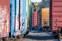 Railroad Cars. A closup of several stationary railcars in a railyard Stock Image