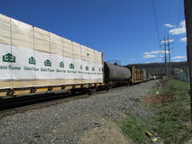 Railroad cars of different kinds going through West Haverstraw, NY. Royalty Free Stock Photos