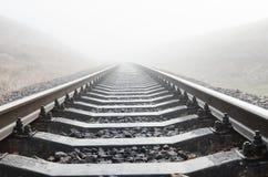 Railroad closeup in fog Royalty Free Stock Photo