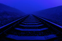 Railroad closeup in night with moonlight Stock Photo