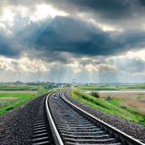 Railroad and clouds over it Stock Photo