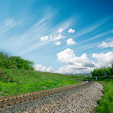 Railroad and cloudy sky Stock Images