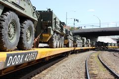 Railroad Convoy of military vehicles. Stock Photo