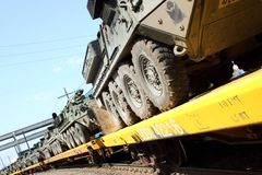 Railroad Convoy of military vehicles. Stock Photos