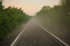Railroad covered with mist, after rain. In the evening Royalty Free Stock Photography