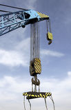 Railroad Crane. Pulley on Railroad Crane against blue sky Stock Images