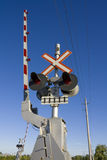 Railroad crossing. In rural area against blue sky Royalty Free Stock Photography