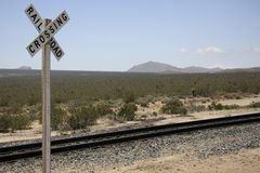 Railroad crossing. Railroad track in the desert with sign railroad crossing Stock Image