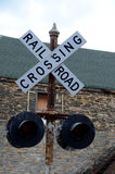 Railroad crossing. Old Railroad sign still in operation Stock Images