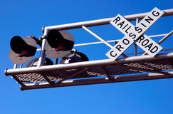 Railroad Crossing. Crossing signal with flashing red lights Royalty Free Stock Photos