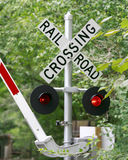 Railroad Crossing. On its way down signaling a train coming Stock Images