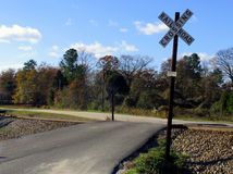 Railroad crossing. Rural railroad crossing in autumn setting stock photography