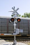 Railroad Crossing. Train crossing - gales are down and lights are flashing - clear summer day royalty free stock images