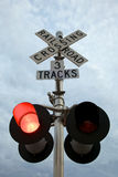 Railroad Crossing. An active railroad crossing sign warns drivers of an approaching train Royalty Free Stock Photography
