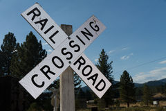 Railroad crossing agains blue sky Stock Image