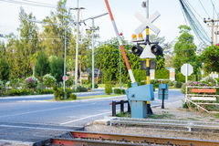 Railroad crossing with barriers. And security system Royalty Free Stock Image