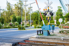 Railroad crossing with barriers. And security system Stock Photo
