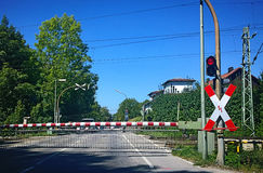 Railroad crossing closed with red light Stock Photo
