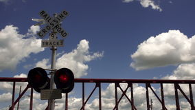 Railroad Crossing Clouds Passing Blue Sky Flashing Red Lights stock video footage
