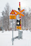 Railroad crossing in cold winter season Royalty Free Stock Photos