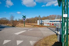 Railroad crossing in Denmark. Railroad crossing in town of Tollose in Denmark Stock Photo