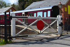 Railroad with crossing gate. Photo showing the gate across the railroad tracks at a station. Photo taken in April 2014 in Staverton U.K Royalty Free Stock Images