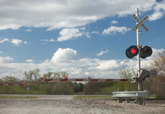 Railroad Crossing. The guard is down and lights are flashing at the train crossing Royalty Free Stock Photos