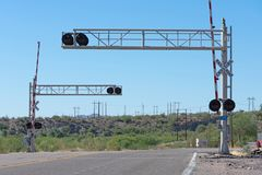 Railroad crossing with lights in the heart of Arizona royalty free stock photography