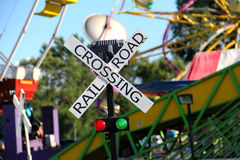 Railroad Crossing. A miniature railroad crossing sign at a festival Stock Images