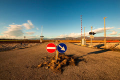 Railroad crossing with mountains behind Stock Photos