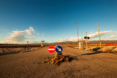 Railroad crossing with mountains behind Royalty Free Stock Photography